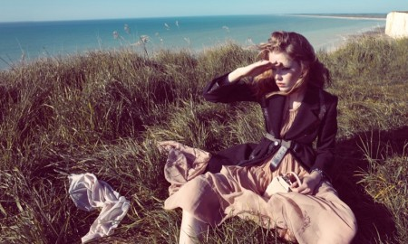 The model poses in windswept looks for the fashion editorial