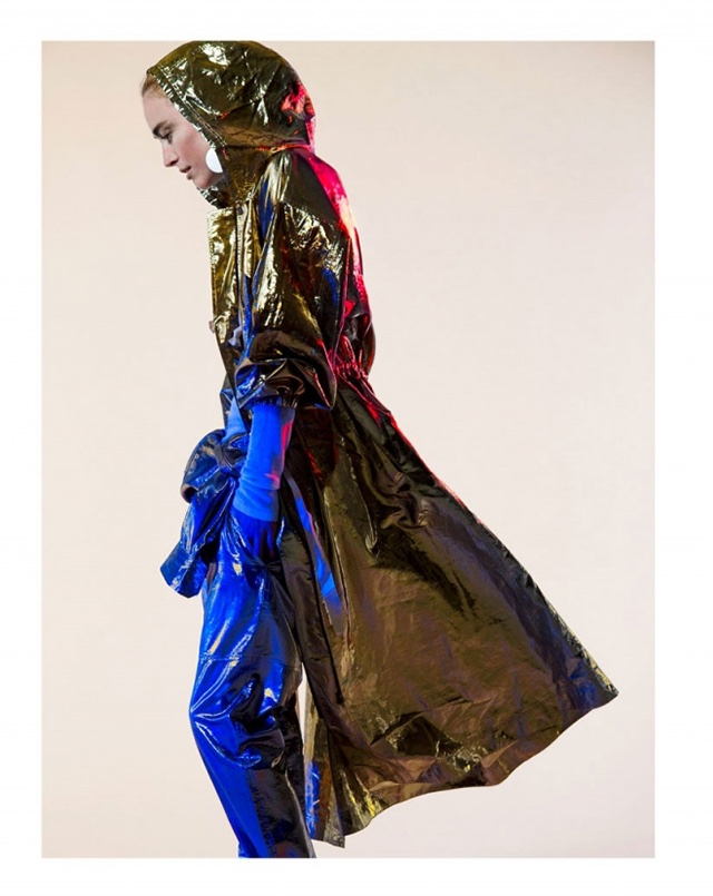 The model poses in a gold metallic and hooded jacket by Isabel Marant
