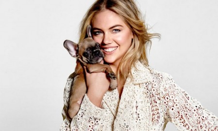 The top model poses with cute puppies in the fashion shoot