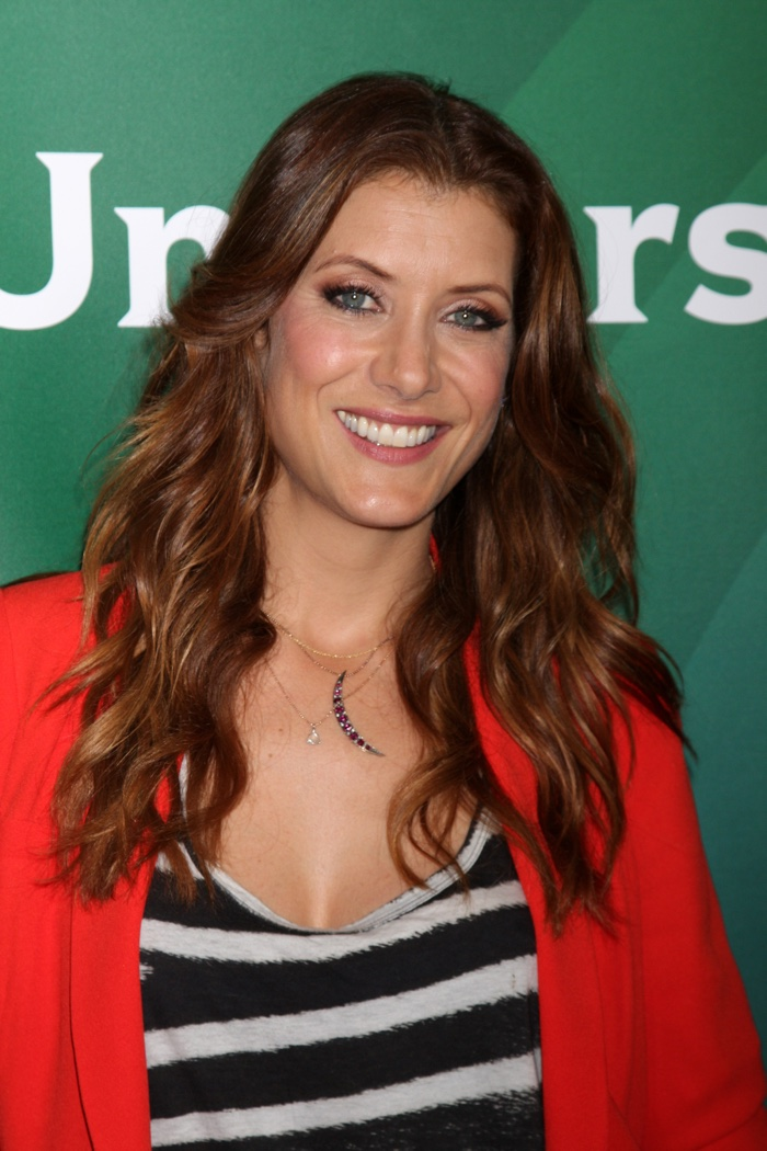 Actress Kate Walsh shows off a medium auburn shade with romantic waves and golden highlights.