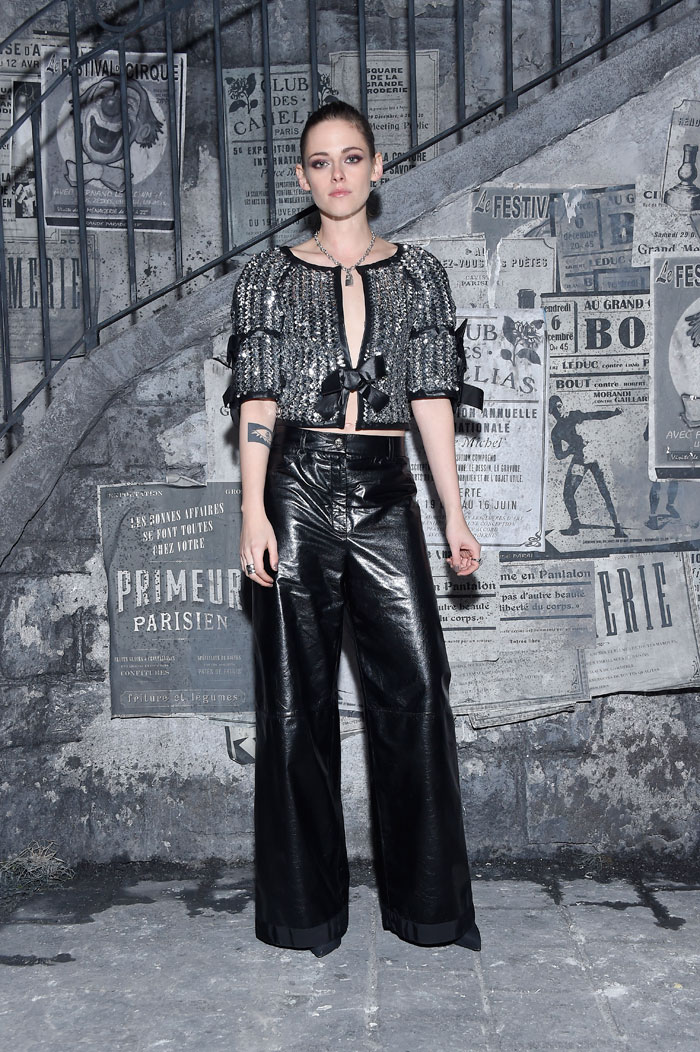 Kristen Stewart at Chanel's Metiers d'Art pre-fall 2016 show in Rome wearing a silver top and black trousers. Photo: courtesy Chanel