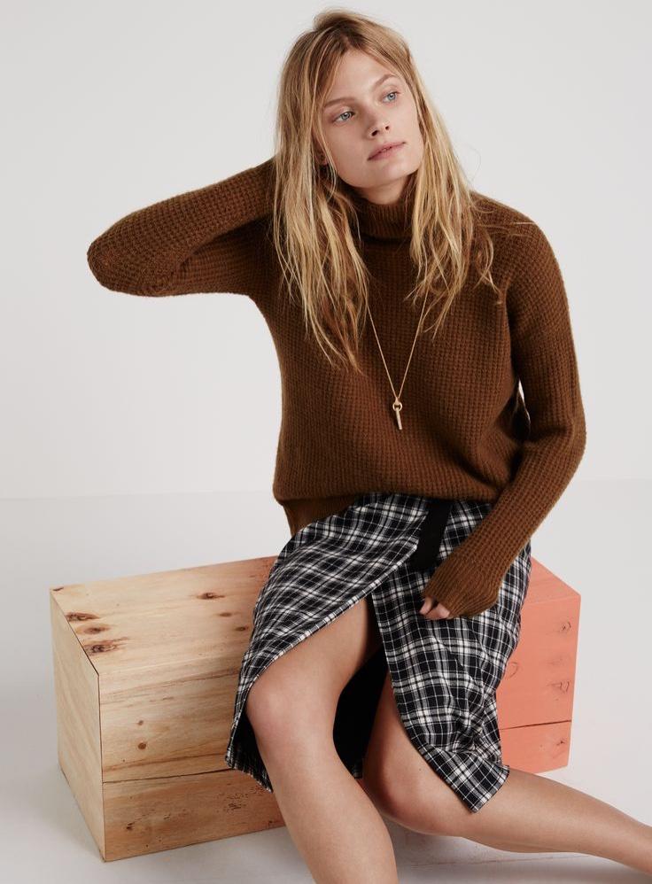 Madewell wafflestitch turtleneck, plaid wrap skirt and pavé cylinder necklace.