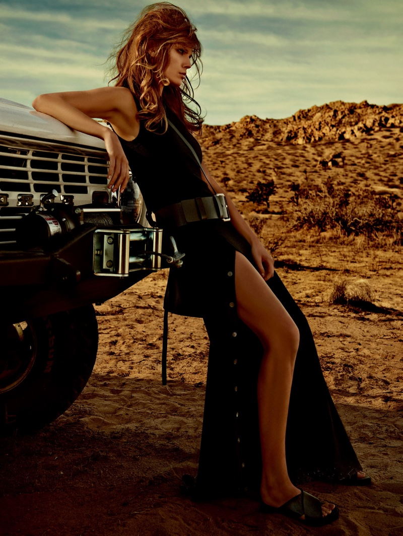 The model poses in the desert while wearing sultry looks