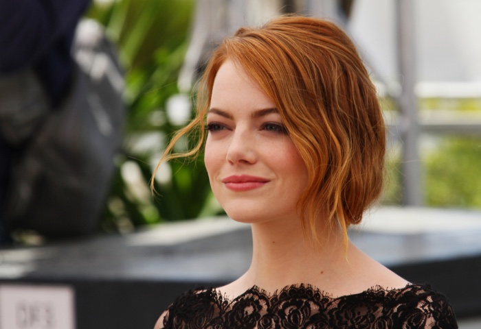 Emma Stone wears a bold red lip color.