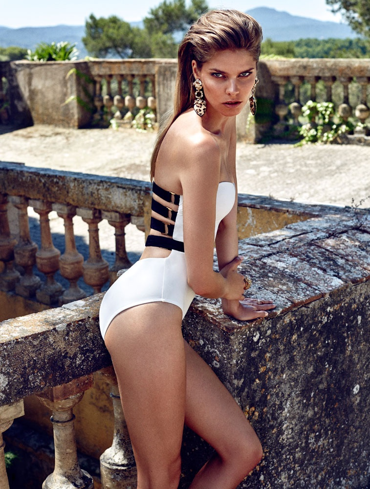 The model wears swimsuit looks photographed by Xavi Gordo