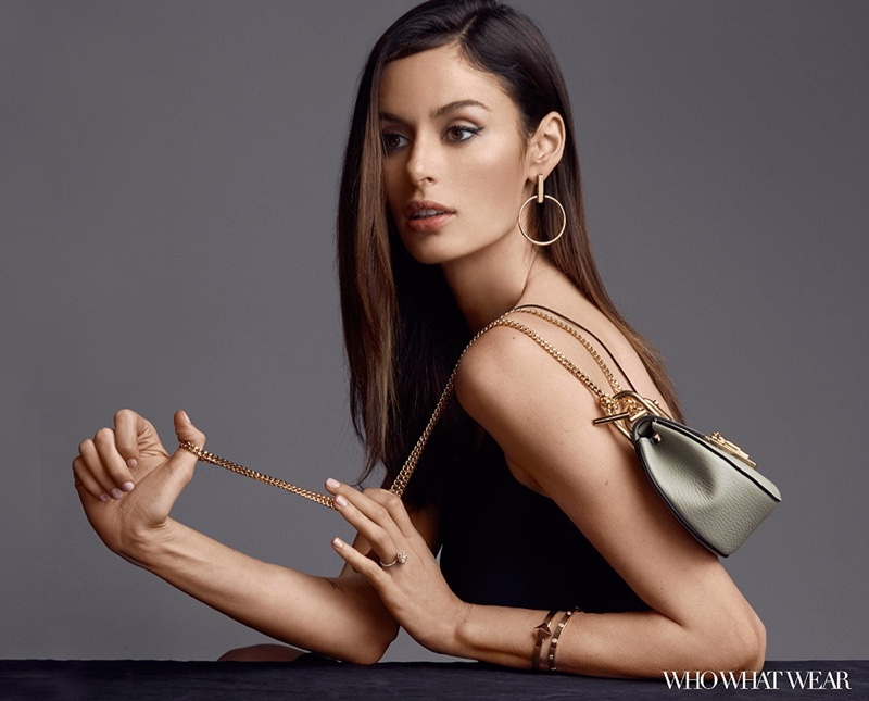 The model shows ways to accessorize a black slip dress