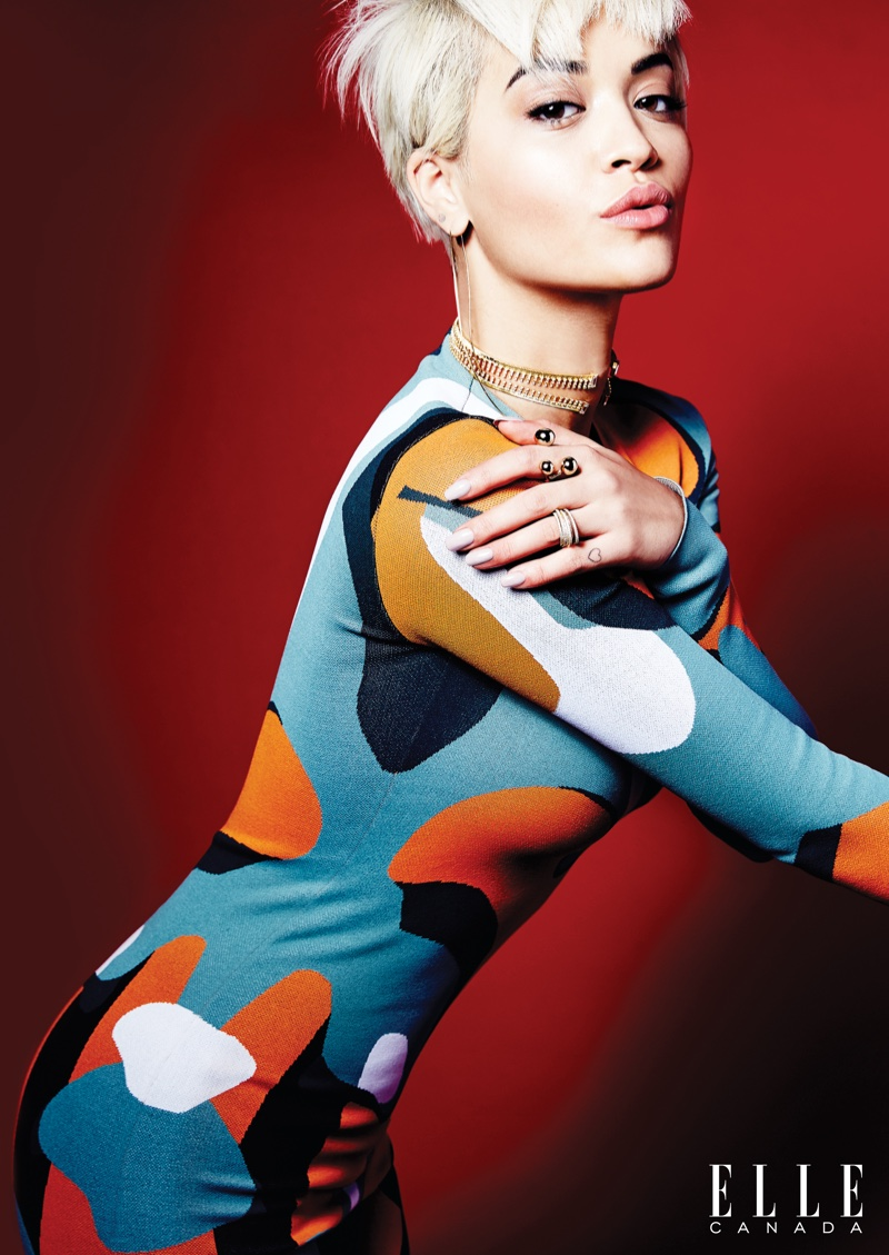 Rita poses in a whimsical  print catsuit from Dior