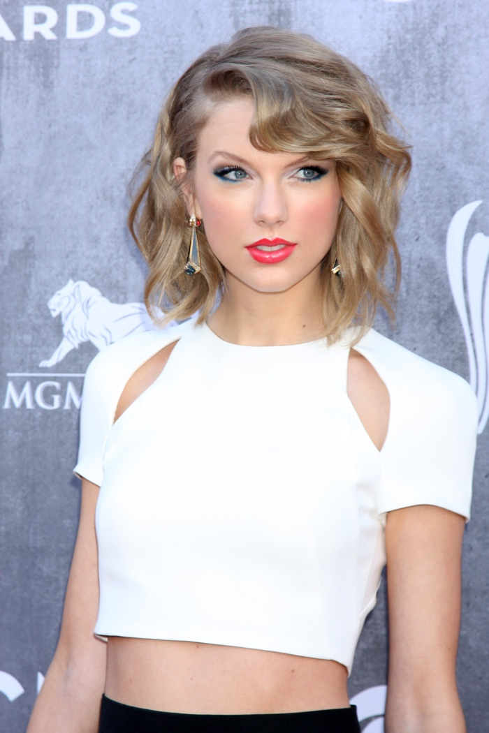 Taylor Swift works her short hairstyle again with a wavy 'do featuring a side part. Photo: Helga Esteb / Shutterstock.com