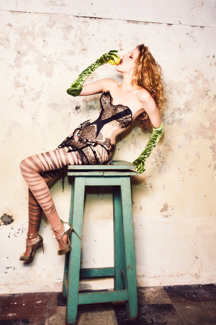 SITTING PRETTY: Alisa models corset  bodysuit with lace details and green gloves