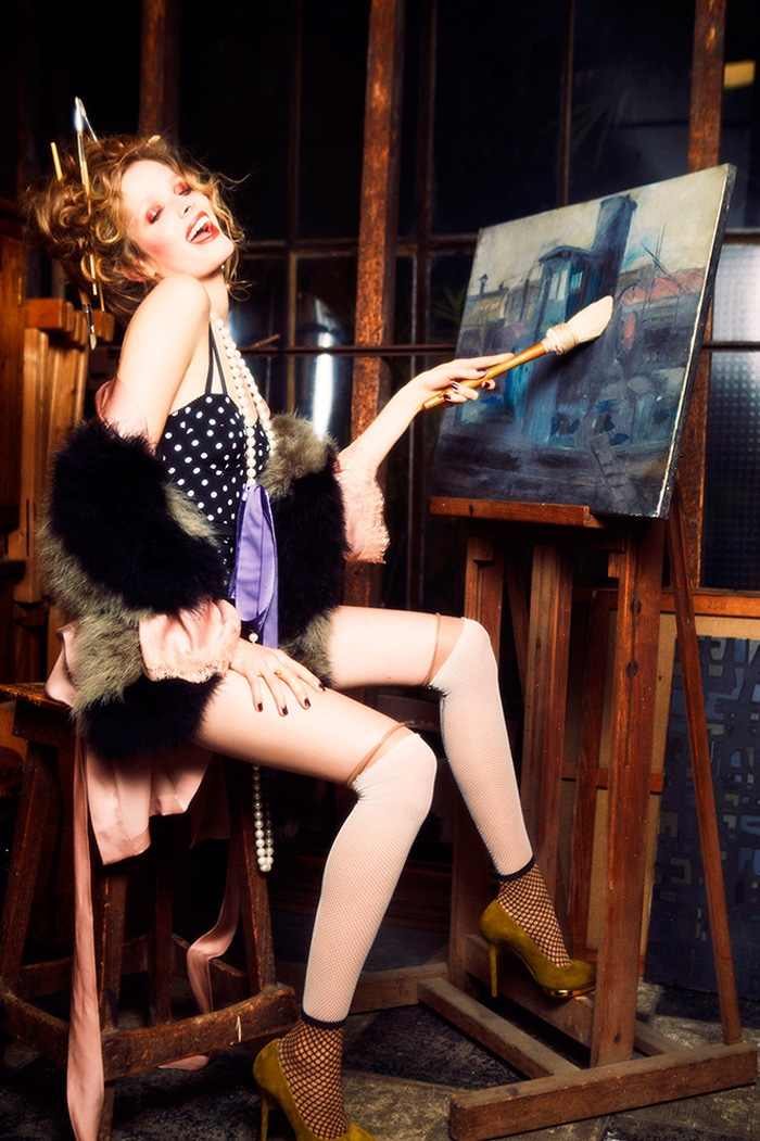 PAINTING IN STYLE: Alisa picks up a brush in a polka dot number with stockings