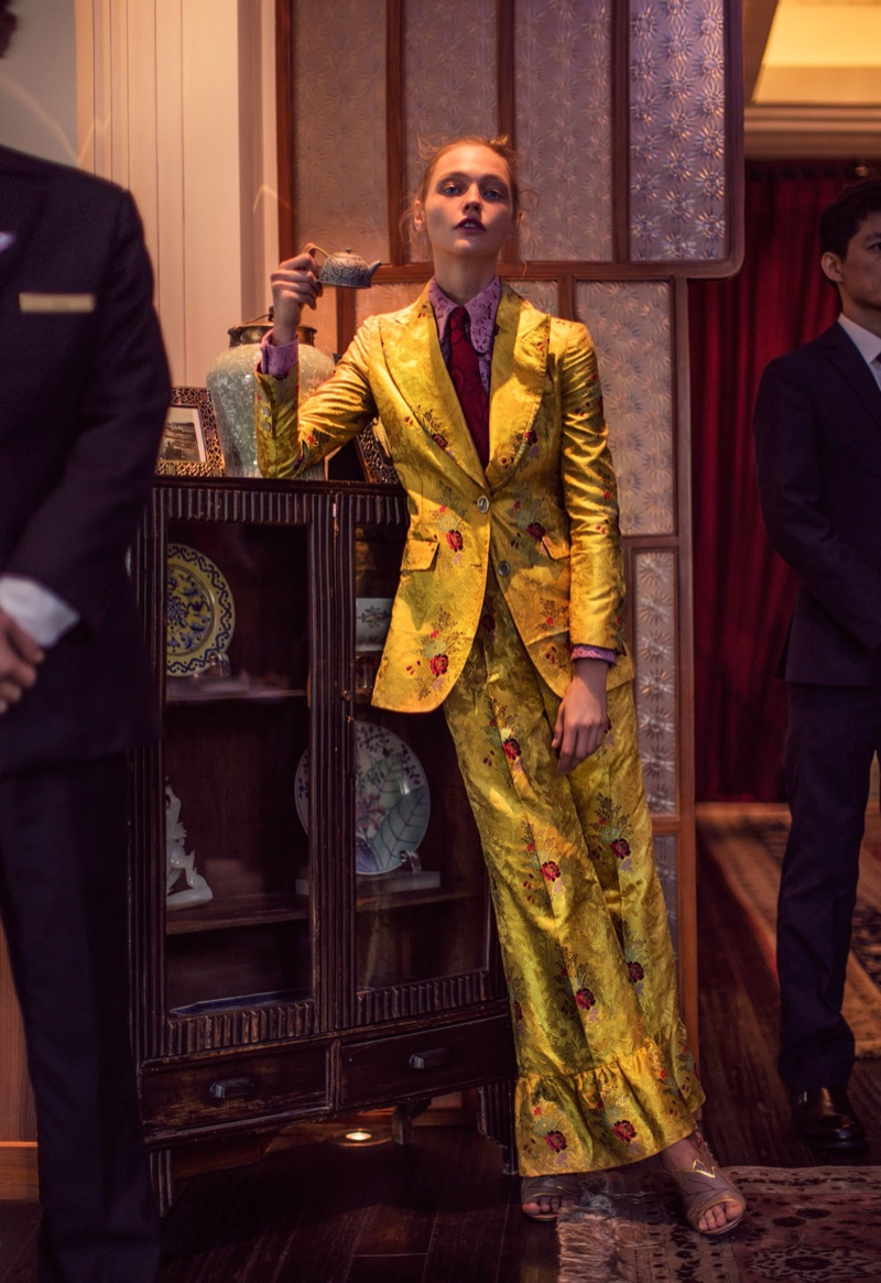 SUIT UP: Sasha models a yellow brocade Gucci pantsuit