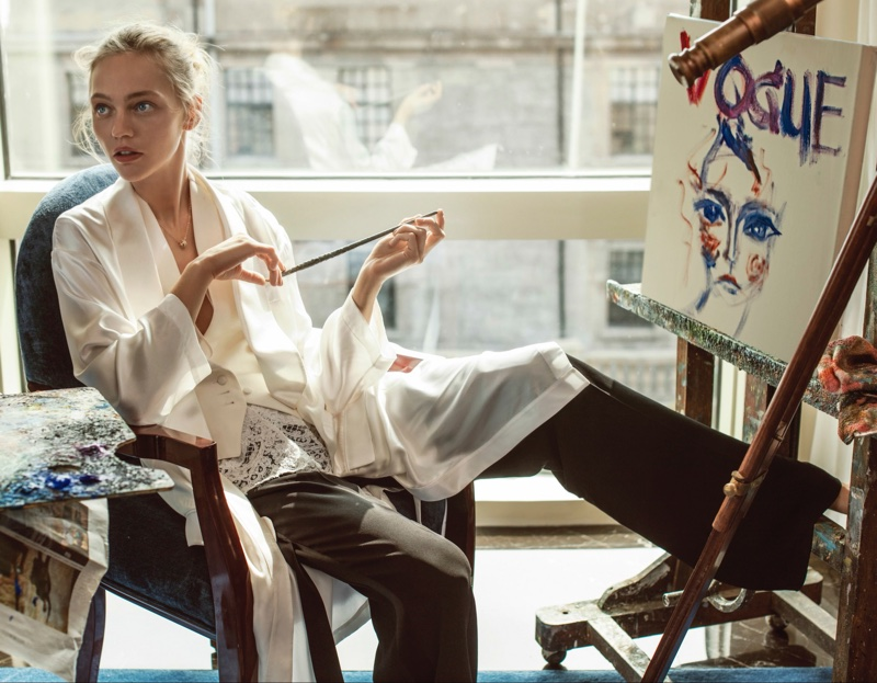 PAINTING BEAUTY: Sasha Pivovarova poses next to her artwork in white vest and black trousers