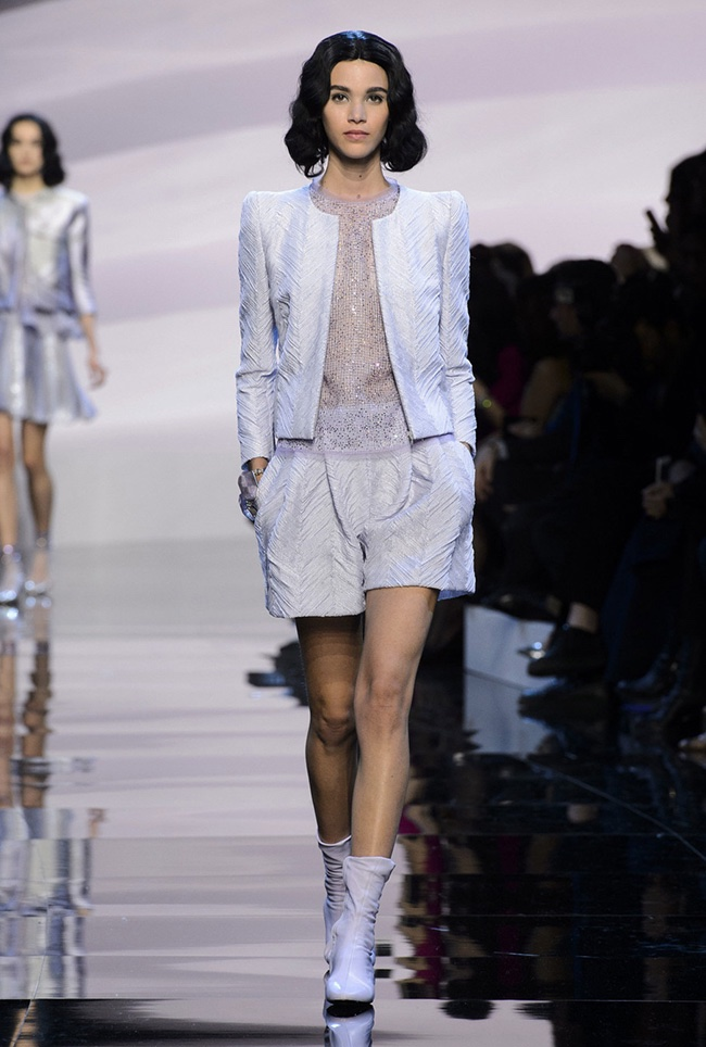 A model walks the runway at Armani Prive's spring 2016 haute couture runway show wearing a jacket and shorts look