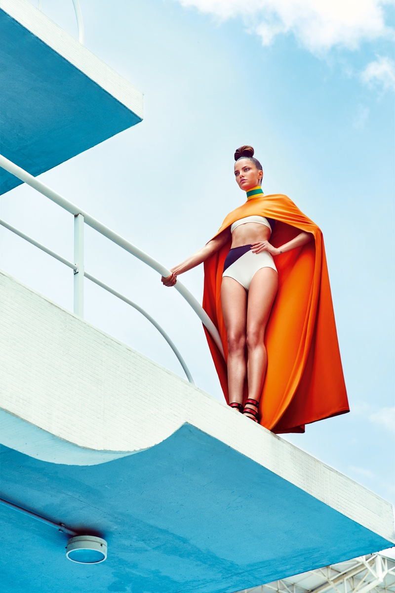 WONDER WOMAN: The model pairs her white swimsuit with a dramatic cape
