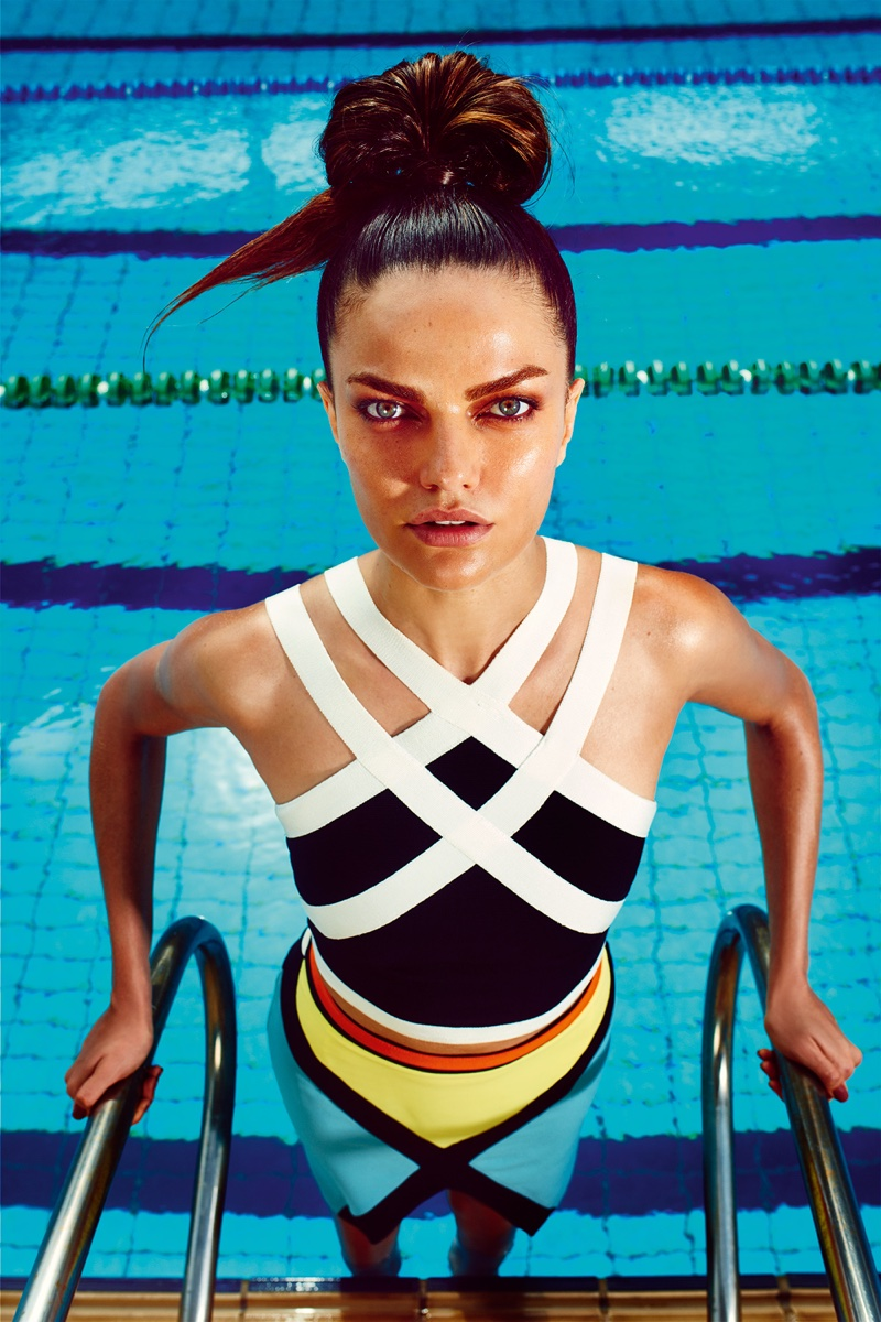 DIVE IN: The model hits the pool in a bodycon dress with criss-cross strap details