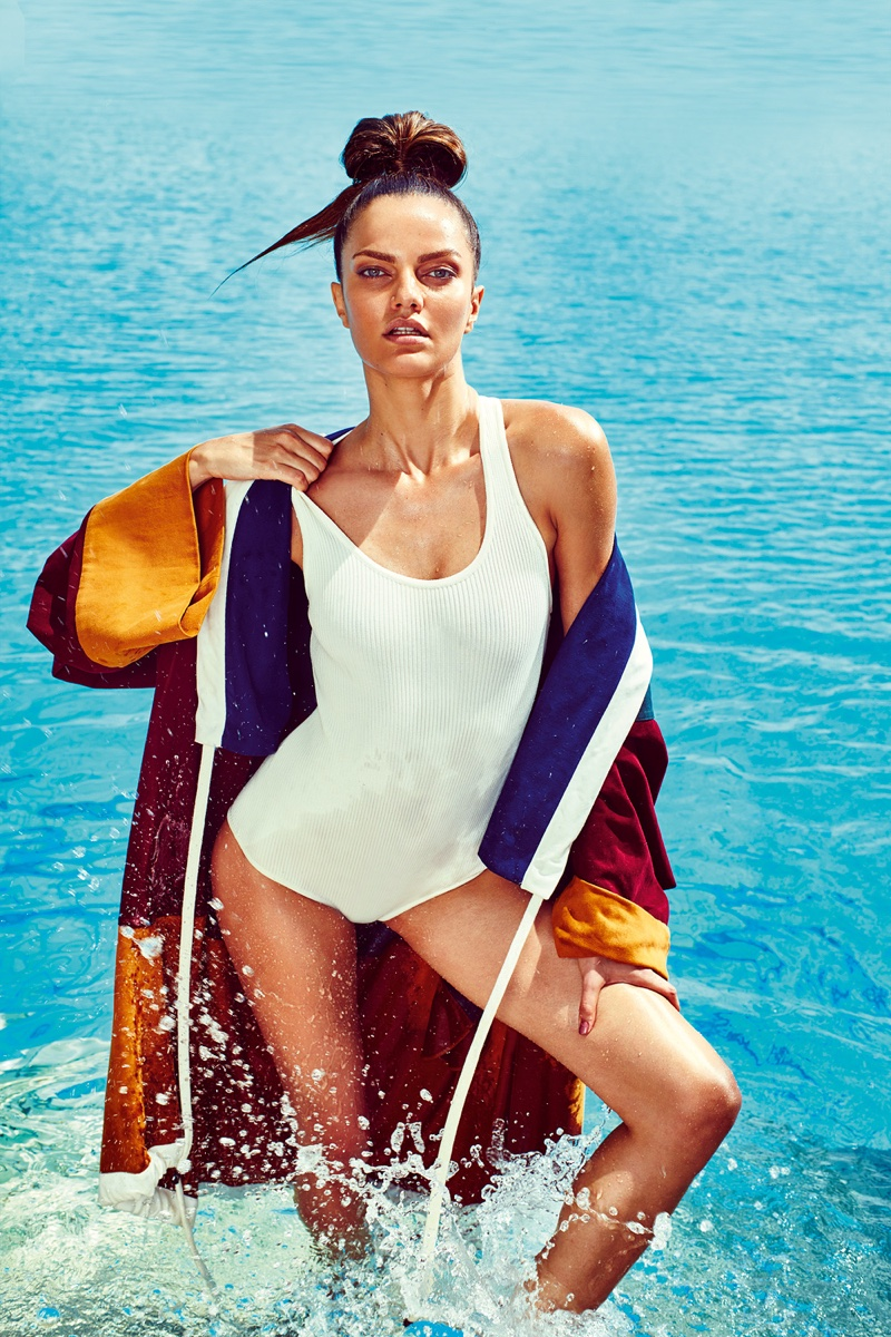 SWIM DAZE: Barbara models white one-piece swimsuit and multicolored jacket