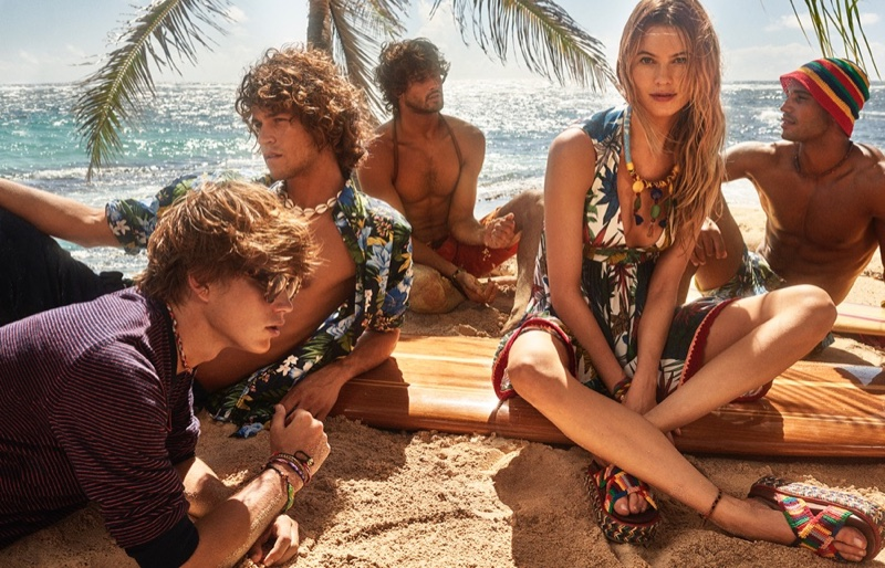 Behati Prinsloo poses with a group of hunky guys in Tommy Hilfiger's spring 2016 campaign