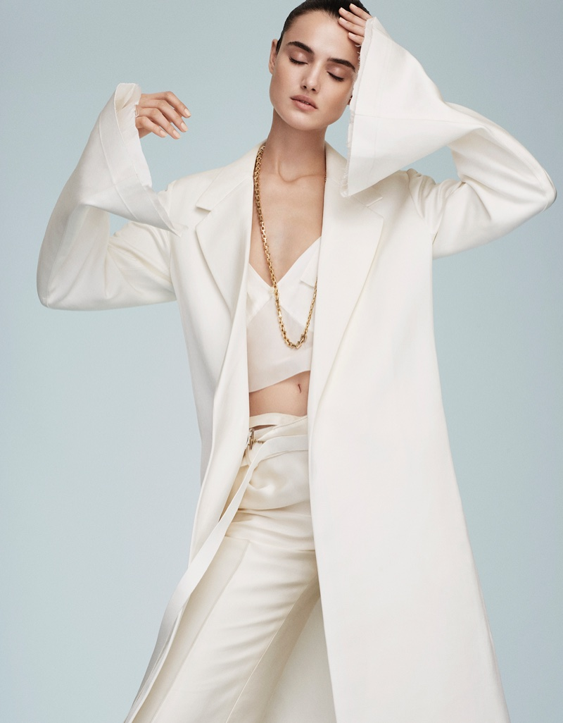 Blanca models Calvin Klein Collection coat, bra top and pants