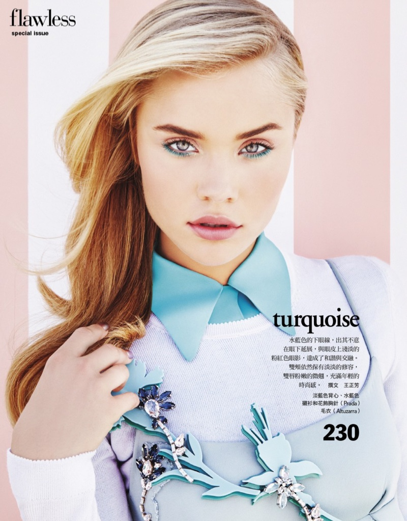 The blonde model wears a Prada dress