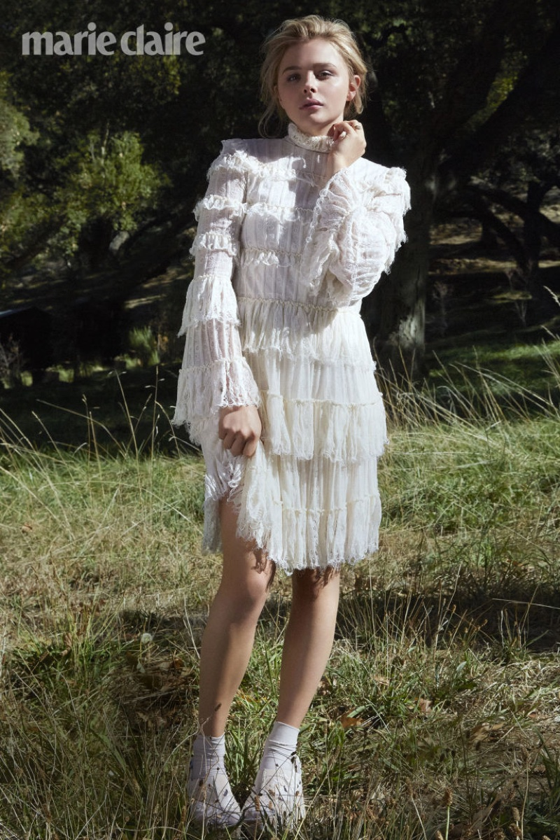Chloe Grace wears a ruffled adorned white lace dress