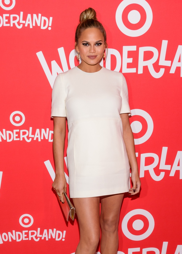 DECEMBER 2015: Pregnant Chrissy Teigen attends Target Wonderland event wearing a white Victoria Beckham dress. Photo: Eastjord Productions / Shutterstock.com