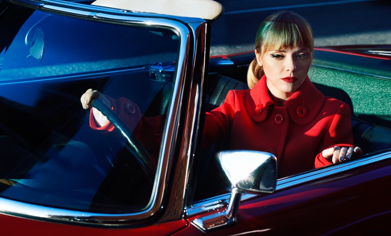 Christina oozes ladylike glamour in a red coat for the photoshoot