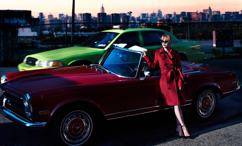 The actress is the very image of elegance in a red trench coat and sunglasses