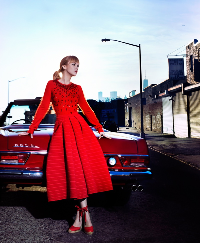 Posing next to a vintage Mercedes-Benz, Christina Ricci models a red long-sleeve fit and flare dress