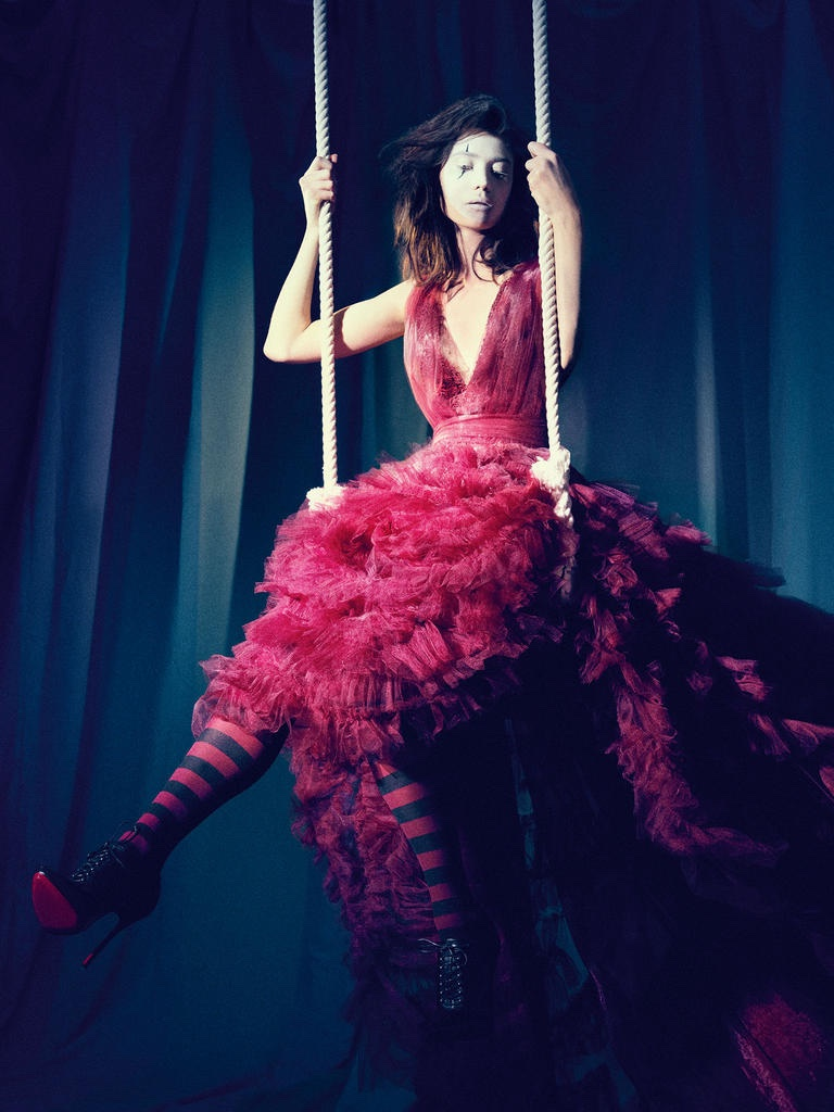 SWING, SWING: Model poses in Marchesa dress and Christian Louboutin boots