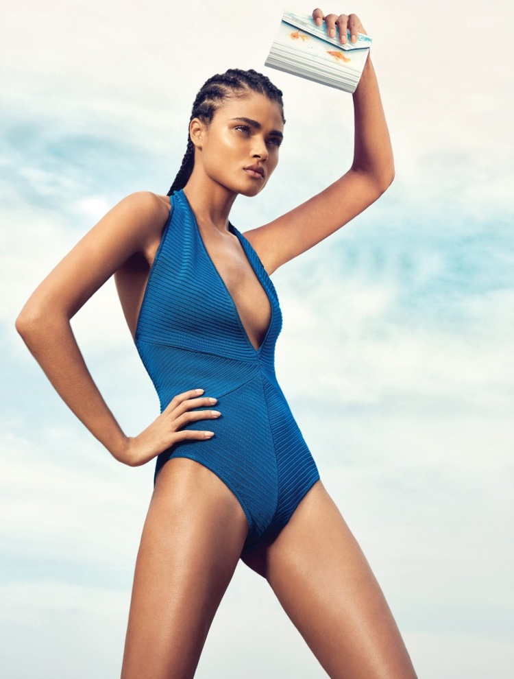 The model wears a hairstyle with cornrows in the beach shoot