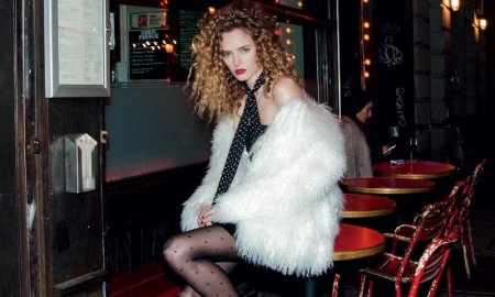 GLAMOUR GIRL: Daria models a white fur coat and black dress with halter top neck