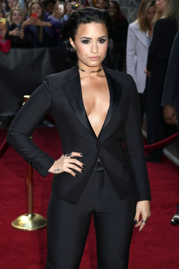 DECEMBER 2015: Demi Lovato attends the 10th Annual Billboard Women in Music event wearing a black pantsuit. Photo: JStone / Shutterstock.com