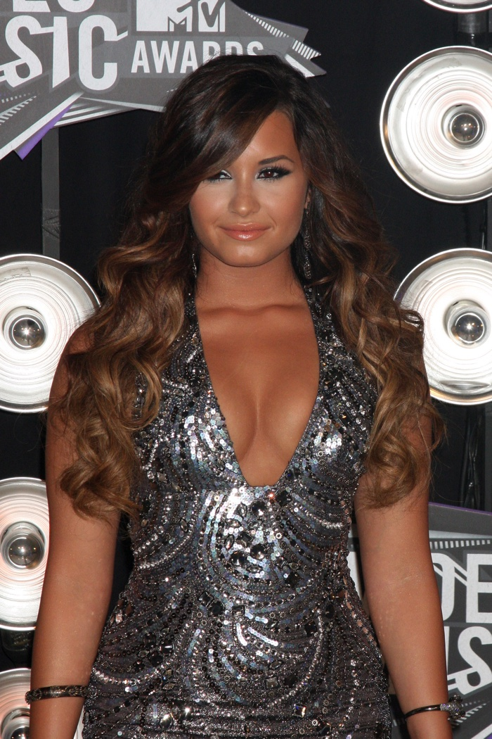 Showing off a new look at the 2011 Video Music Awards, Demi Lovato wore her hair in long and brown ombre waves. Photo: Joe Seer / Shutterstock.com