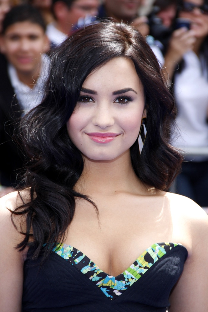 Demi Lovato showed off a long and wavy hairstyle featuring a darker shade of brown at a 2010 movie premiere. Photo: Tinseltown / Shutterstock.com