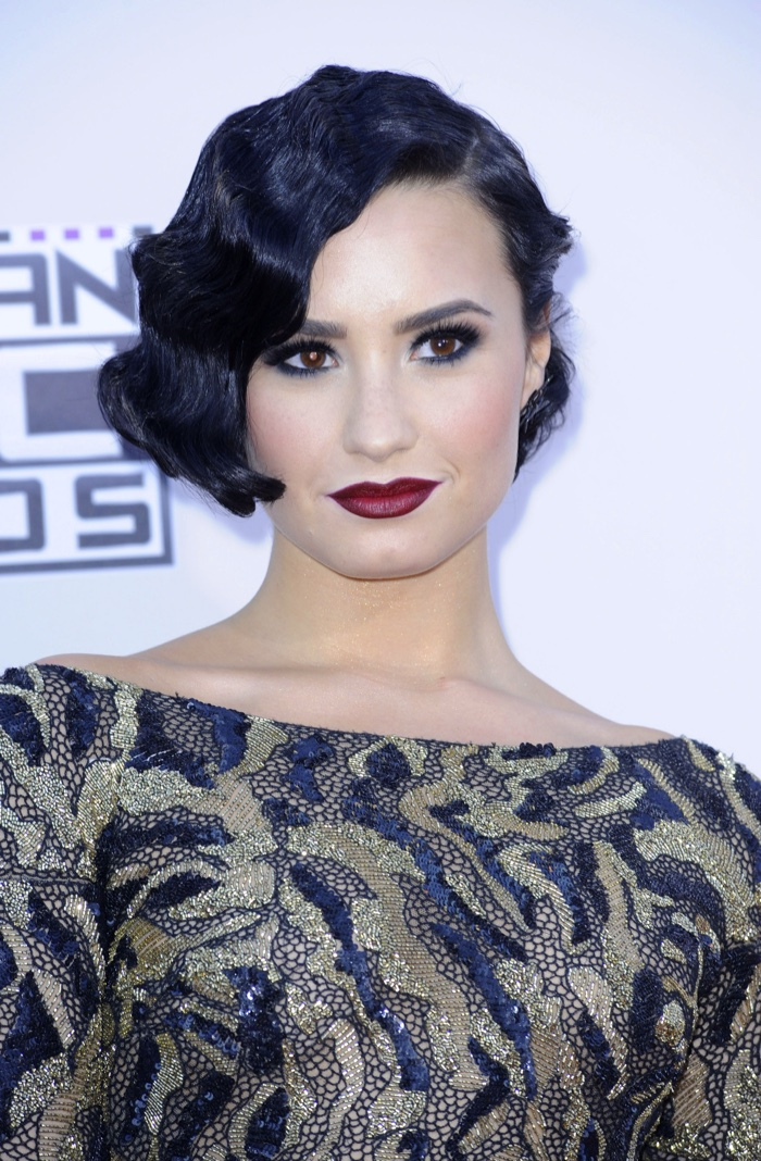 Singer Demi Lovato channels 1920s hair with a short finge rwave hairstyle.