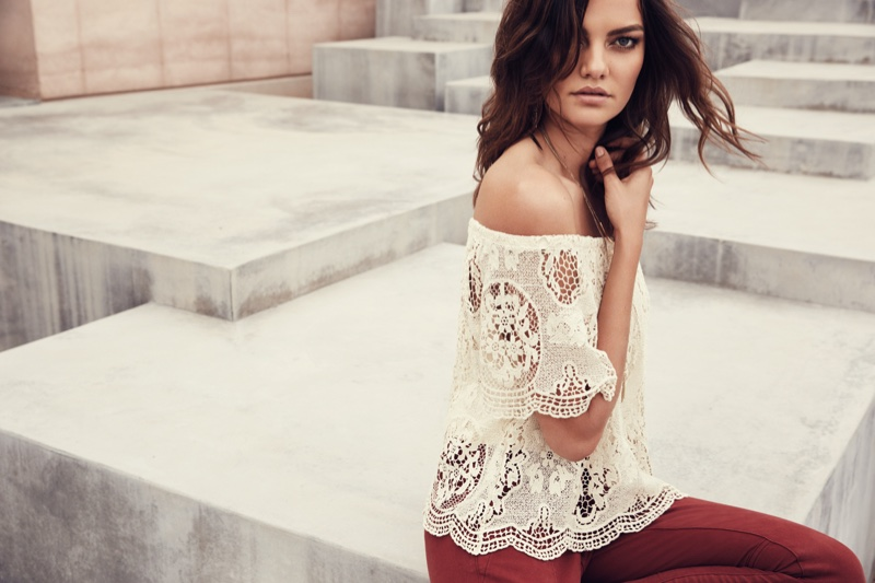 Barbara wears lace top from Dynamite's spring 2016 collection