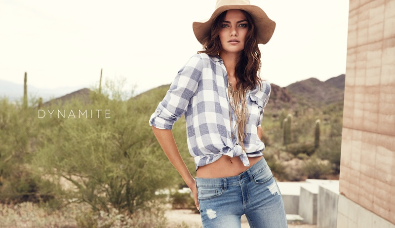 Barbara wears floppy hat, plaid shirt and denim pants from Dynamite's spring collection