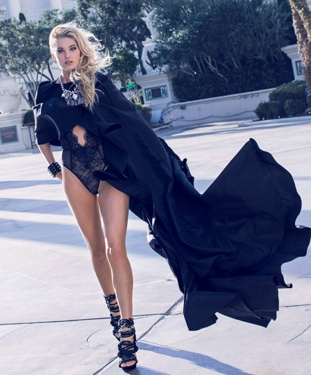 Elsa Hosk has a sexy moment in black cape and lingerie look