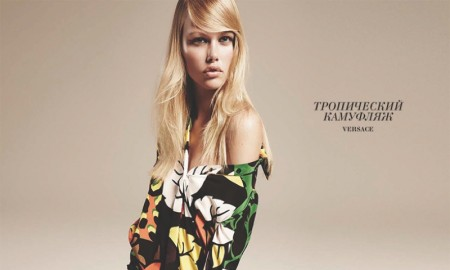 JUNGLE JUMBLE: Emma poses in printed top and trousers from Versace