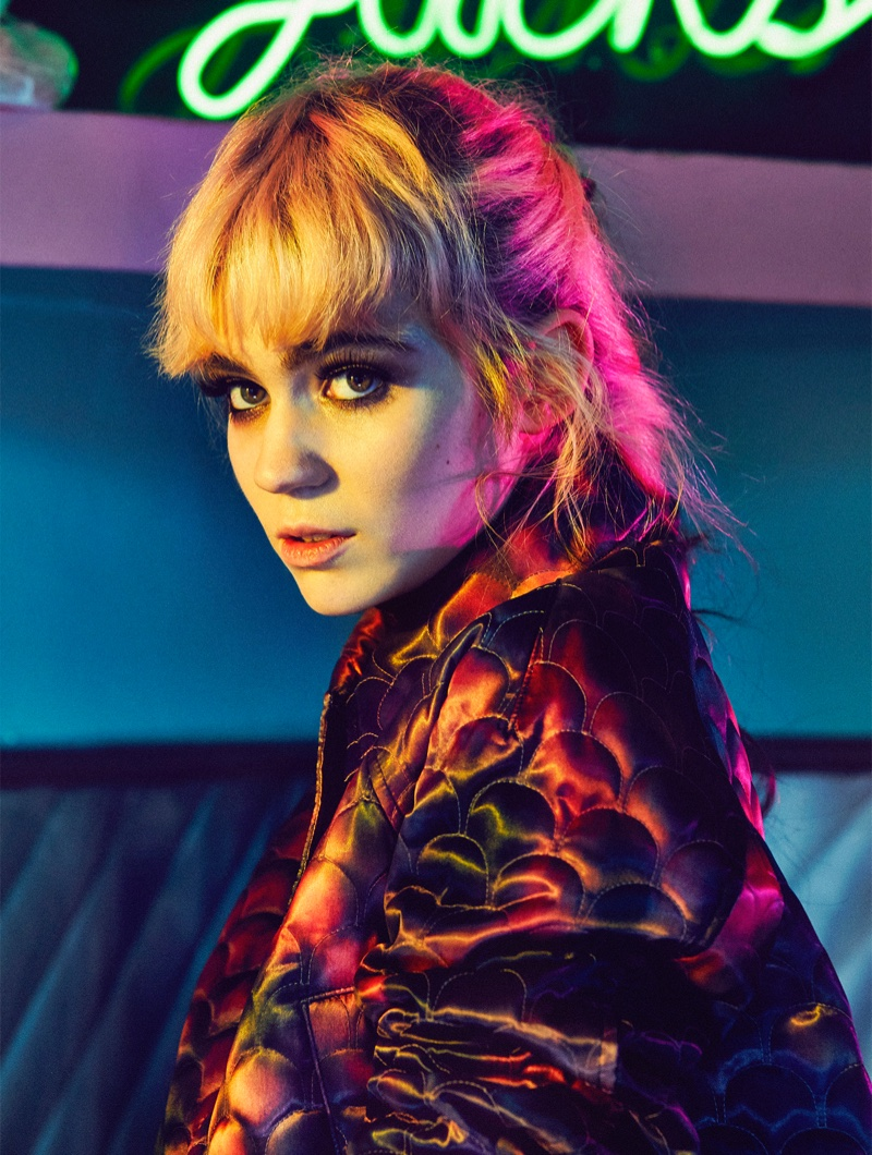Grimes wears blunt bangs with a coat by Louis Vuitton