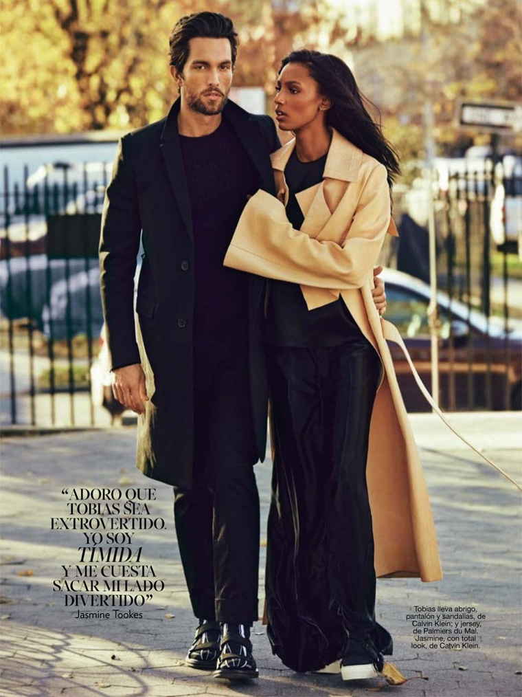 The model pair wears his & hers style with coat looks