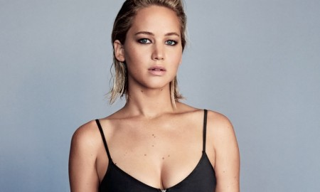 Jennifer Lawrence poses in a black bikini look with high-waist bottoms