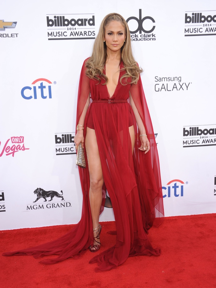 At the 2014 Billboard Music Awards, Jennifer Lopez looked sexy in a red Donna Karan dress, flashing plenty of leg. Photo: DFree / Shutterstock.com