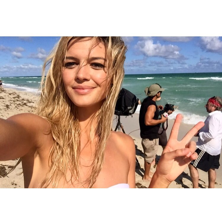 Kelly Rohrbach takes a selfie on the beach while shooting Calzedonia campaign