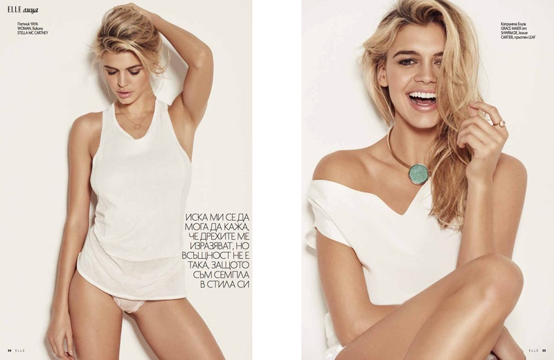 LIGHT-HEARTED: Kelly is all smiles in a white off-the-shoulder number