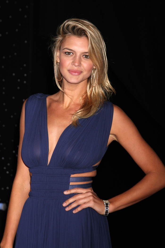 DECEMBER 2015: Kelly Rohrbach attends the Los Angeles premiere of Star Wars: The Force Awakens wearing a blue pleated mini dress. Photo: Helga Esteb / Shutterstock.com