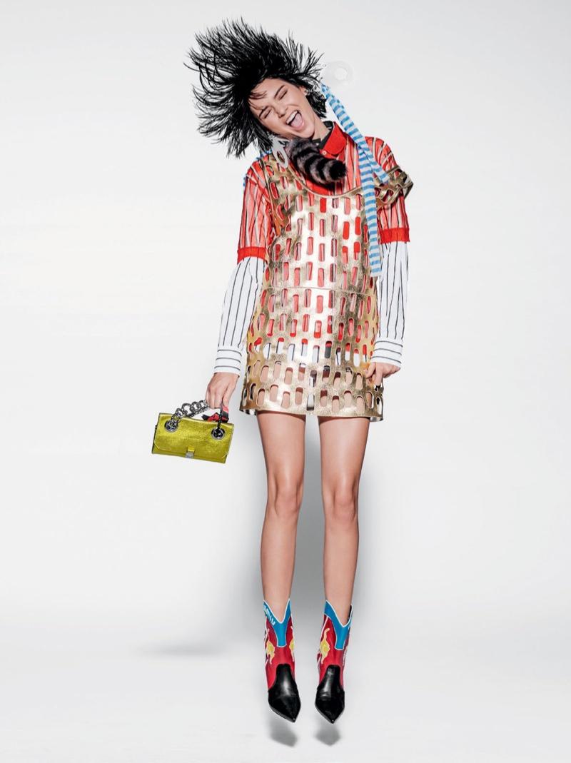 MINI MOMENT: Kendall poses in a peekaboo metallic shift dress