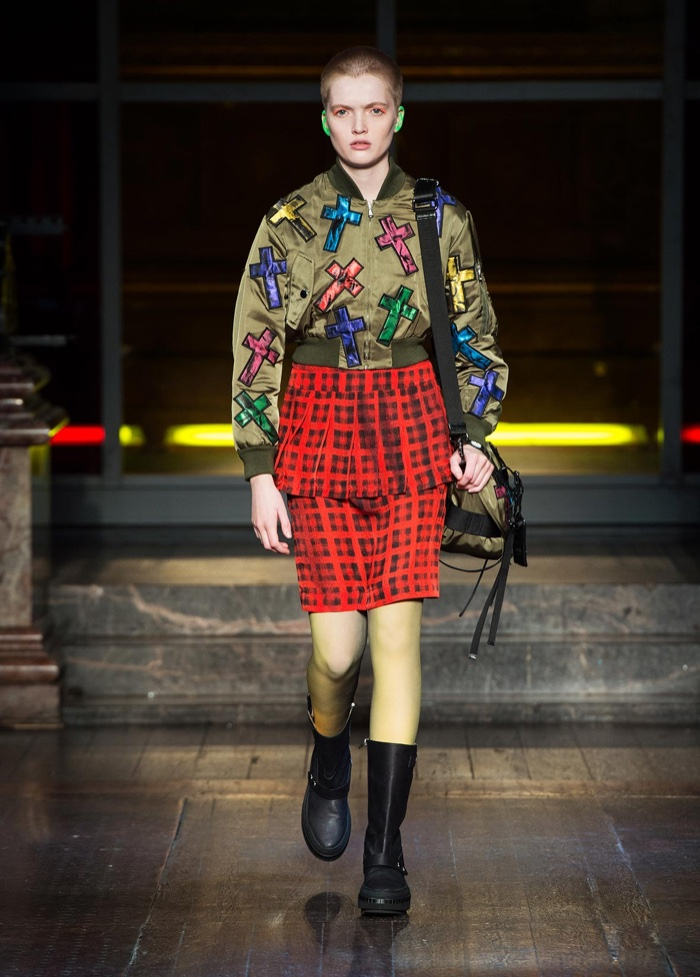 RAD IN PLAID: Ruth Bell walks the runway at Moschino's fall-winter 2016 show wearing a plaid skirt and cross embellished bomber jacket with combat boots