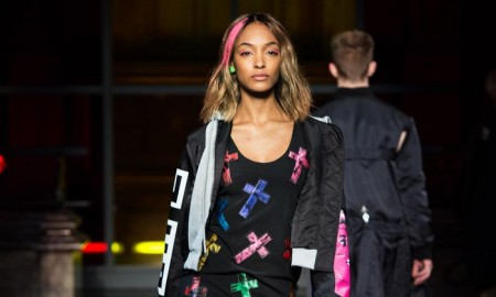 PRETTY IN PUNK: Jourdan Dunn walks the runway at Moschino's fall-winter 2016 show wearing a cross embellished shift dress and bomber jacket with combat boots.