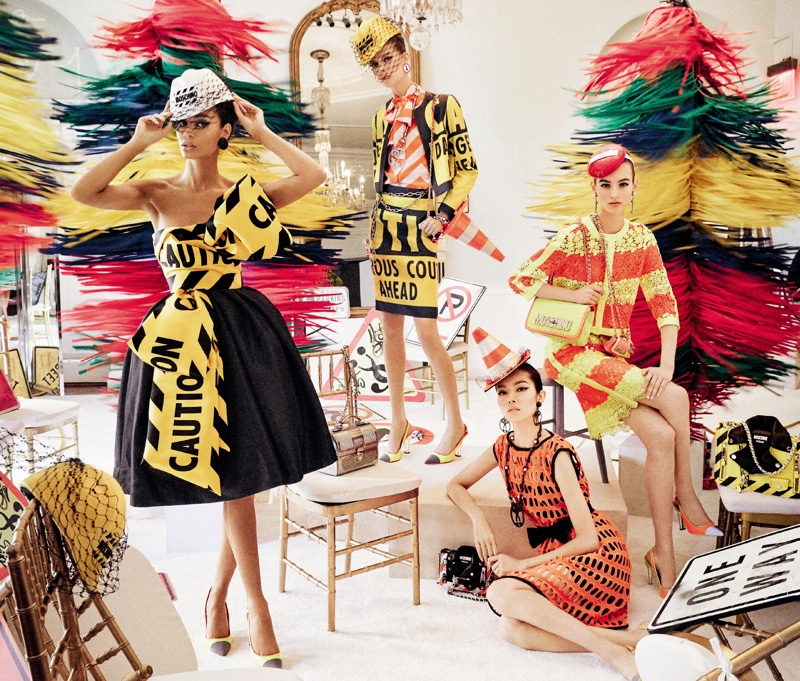 Inspired by cautionary signage, Moschino's spring 2016 campaign is full of vibrant colors